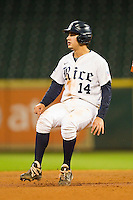 J.T. Chargois #14 of the Rice Owls puts on the brakes as he rounds second base against the Texas Longhorns at Minute Maid Park on March 2, 2012 in Houston, Texas.  The Longhorns defeated the Owls 11-8.  (Brian Westerholt/Four Seam Images)