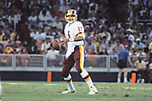 Washington Redskins quarterback Mark Rypien (11) looks for a receiver during a pre-season game against the Miami Dolphins at RFK Stadium in Washington, D.C. on August 25, 1989.  The Redskins won the game 35 - 21.<br /> Credit: Arnold Sachs / CNP