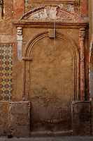 "Detail of a bricked up doorway with pediment decorated with carved foliage and old ceramics, old city, Portuguese Fortified city of Mazagan, El Jadida, Morocco. El Jadida, previously known as Mazagan (Portuguese: Mazag""o), was seized in 1502 by the Portuguese, and they controlled this city until 1769. Picture by Manuel Cohen"