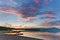 Morning sunrise over Naknek lake and a super cub bush plane on floats along the shore, Katmai National Park, southwest, Alaska.