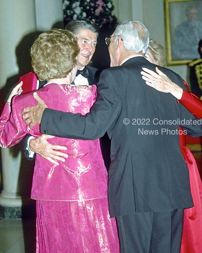 Washington, DC - (FILE) -- United States President Ronald Reagan and Prime Minister Margaret Thatcher of Great Britain and their spouses embrace after sharing a dance in the Entrance Hall of the the White House in Washington, D.C. following the dinner in her honor on Wednesday, November 16, 1988.  .Credit: Ron Sachs / CNP