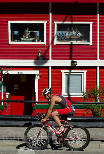 25 AUG 2013 - STOCKHOLM, SWE - A competitor cycles along the Söder Mälarstrand during the Stockholm Triathlon in Stockholm, Sweden (PHOTO COPYRIGHT © 2013 NIGEL FARROW, ALL RIGHTS RESERVED)
