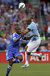 23 May 2013:  Vincent Kompany (right)(BEL) of Manchester City competes for a headball against Demba Ba (left)(FRA) of Chelsea.  Chelsea F.C. was defeated by Manchester City 3-4 at Busch Stadium in Saint Louis, Missouri, in a friendly exhibition soccer match.