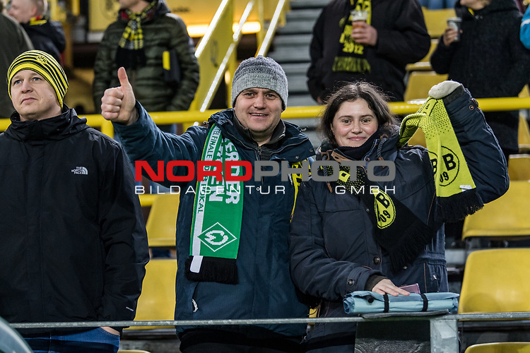 05.02.2019, Signal Iduna Park, Dortmund, GER, DFB-Pokal, Achtelfinale, Borussia Dortmund vs Werder Bremen<br /> <br /> DFB REGULATIONS PROHIBIT ANY USE OF PHOTOGRAPHS AS IMAGE SEQUENCES AND/OR QUASI-VIDEO.<br /> <br /> im Bild / picture shows<br /> Werder Fan und Borussia Fan auf Tribüne, <br /> <br /> Foto © nordphoto / Ewert