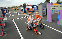 WARMINSTER, PA - OCTOBER 7: Patrick McCarty (L), 4, and Dominic Alessi, 4, both of Warminster, Pennsylvania ride bicycles at Safety Town at Warminster Community Park October 7, 2014 in Warminster, Pennsylvania. Safety Town is a miniaturized version of Warminster Township where young children can ride bikes and play in a make-believe town. The safety signs and street markings have been shrunk down to smaller size to help teach the importance of street safety.  (Photo by William Thomas Cain/Cain Images)