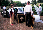 Country House Auction at Newnham Hall Northamptonshire 1994. Chritsies auction 1990s UK. Nicholas Thornhill buyer of the portrait of Miss Temperance Gell and loading it into his car.