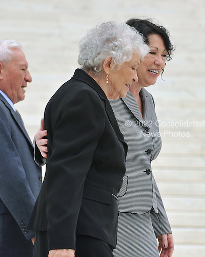Washington, DC - September 8, 2009 -- Associate Supreme Court Justice Sonia Sotomayor  escorts her mother, Mrs. Celina Sotomayor, from the photo-op following the investiture ceremony in her honor at the United States Supreme Court in Washington, D.C. on Tuesday, September 8, 2009.  At far left is her Stepfather Omar Lopez..Credit: Ron Sachs / CNP