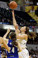 Penn guard/forward Camryn Buhr (34) puts up a shot in traffic during the IHSAA Class 4A Girls Basketball State Championship Game on Saturday, Feb. 27, 2016, at Bankers Life Fieldhouse in Indianapolis.