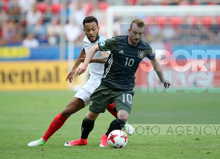 England's Lewis Baker tussles with Germany's Maximilian Arnold during the UEFA Under 21 Semi Final at the Stadion Miejski Tychy in Tychy. Picture date 27th June 2017. Picture credit should read: David Klein/Sportimage