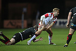 Ulster scrum half Paul Marshall looks for support as Dragons hooker Steve Jones makes the tackle..Celtic Laegue.Newport Gwent Dragons v Ulster.Rodney Parade.26.10.12.©Steve Pope