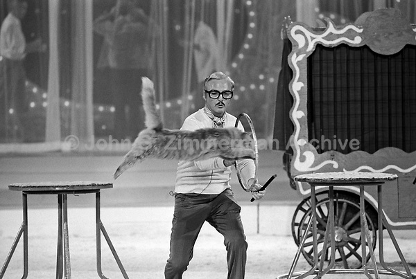 "Actor Jack Cassidy in action as Ringmaster with jumping cat at the ""Circus of the Stars,"" (CBS Special), Santa Monica Civic Auditorium, November, 1976. Photo by John G. Zimmerman"