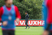 Team manager Chris Coleman appears deep in thought during Wales national team training at Vale Resort, Hensol, Wales on 4 September 2017, ahead of the side's World Cup Qualification match against Moldova. Photo by Mark  Hawkins.