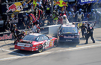 Sept. 28, 2008; Kansas City, KS, USA; Nascar Sprint Cup Series driver Carl Edwards (99) hits Brian Vickers (83) on pit road during the Camping World RV 400 at Kansas Speedway. Mandatory Credit: Mark J. Rebilas-
