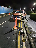 Pictured: The Ford Fiesta car impaled by a railing.<br /> Re: A man escaped when his car crashed into a pedestrian railing, leaving his car impaled.<br /> The 21 year old male driver narrowly avoided the railing, which smashed through to the rear seats, South Wales Police said.<br /> The accident happened at Morriston Hospital car park in Swansea shortly after 5.30pm on Wednesday.<br /> Officers said the driver had been distracted by his sat nav. He was not injured and was given a verbal warning.