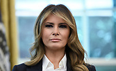 First Lady Melania Trump looks on during a meeting with the members of Team USA for the 2019 Special Olympics World Games in the Oval Office of the Washington, D.C., on July 18, 2019.<br /> Credit: Olivier Douliery / Pool via CNP