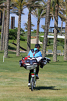 Matteo Manassero (ITA) rides his bike with golf bag during previews ahead of the Rocco Forte Sicilian Open played at Verdura Resort, Agrigento, Sicily, Italy 08/05/2018.<br /> Picture: Golffile | Phil Inglis<br /> <br /> <br /> All photo usage must carry mandatory copyright credit (&copy; Golffile | Phil Inglis)