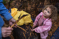 Adele Miroite, 3, talks sticks with her teacher at Fiddleheads Forest School, a nature preschool located in the UW Botanic Gardens Washington Park Arboretum.