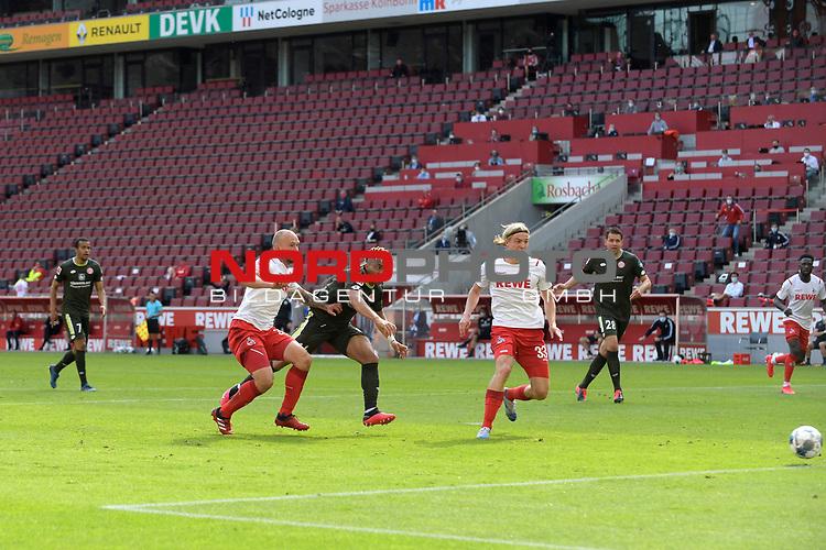 nph00351: Pierre KUNDE (1.FSV Mainz 05) <br /> schiesst <br /> das Tor zum 2-2 gegen <br /> Toni LEISTNER (1.FC Koeln).<br /> Re:Sebastian BORNAUW  (1.FC Koeln)<br /> Sport: Fussball: 1. Bundesliga: Saison 19/20: 26.Spieltag: 1.FC KOELN-FSV MAINZ 05,17.05.2020.<br /> Foto: Anke Waelischmiller/SVEN SIMON/POOL / via Meuter/nordphoto<br /> <br /> Nur für journalistische Zwecke! Only for editorial use!<br /> Gemäß den Vorgaben der DFL Deutsche Fußball Liga ist es untersagt, in dem Stadion und/oder vom Spiel angefertigte Fotoaufnahmen in Form von Sequenzbildern und/oder videoähnlichen Fotostrecken zu verwerten bzw. verwerten zu lassen. DFL regulations prohibit any use of photographs as image sequences and/or quasi-video.