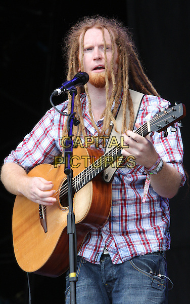 Newton Faulkner.Day 2 of the Hop Farm Festival, nr Paddock Wood, Kent, England..July 2nd 2011.stage concert live gig performance music half length white red check shirt dreadlocks guitar facial hair goatee singing.CAP/JIL.©Jill Mayhew/Capital Pictures