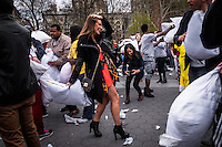 NEW YORK CITY, NY - APRIL 2 : A woman in high hills  takes part during the International pillow fight event in Washington Square Park on April 2, 2016 in New York City, New York. Thousands of people of all ages attend the free global event in different cities worldwide celebrating the 11th annual International Pillow Fight in New York.  Photo by VIEWpress/Maite H. Mateo