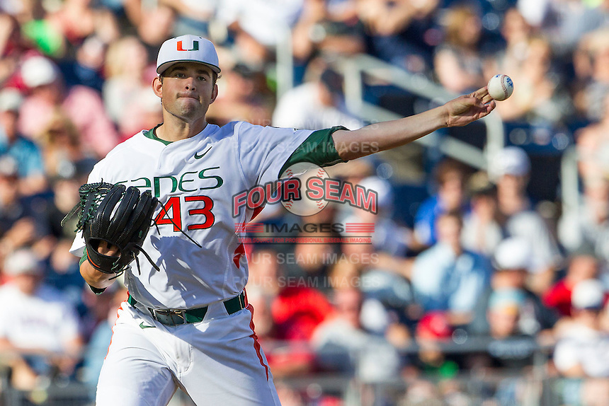 Miami Hurricanes starting pitcher Thomas Woodrey (43) makes a pickoff throw to first base during the NCAA College baseball World Series against the Arkansas Razorbacks  on June 15, 2015 at TD Ameritrade Park in Omaha, Nebraska. Miami beat Arkansas 4-3. (Andrew Woolley/Four Seam Images)