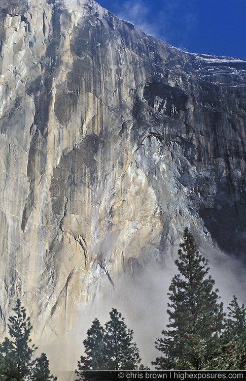 Clearing fog and climbers on El Capitan's North America Wall.