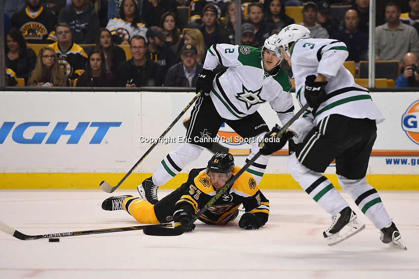 Tuesday, November 3, 2015: Boston Bruins center Ryan Spooner (51) tries to push the puck to a teammate after losing an edge during the National Hockey League game between the Dallas Stars and the Boston Bruins held at TD Garden, in Boston, Massachusetts. Dallas defeats Boston 5-3 in regulation time. Eric Canha/CSM
