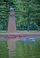 Kayakers pass The Fox River Shore Light is a decorative light, Fabyan Forest Preserve, Geneva, Kane County, Illinois