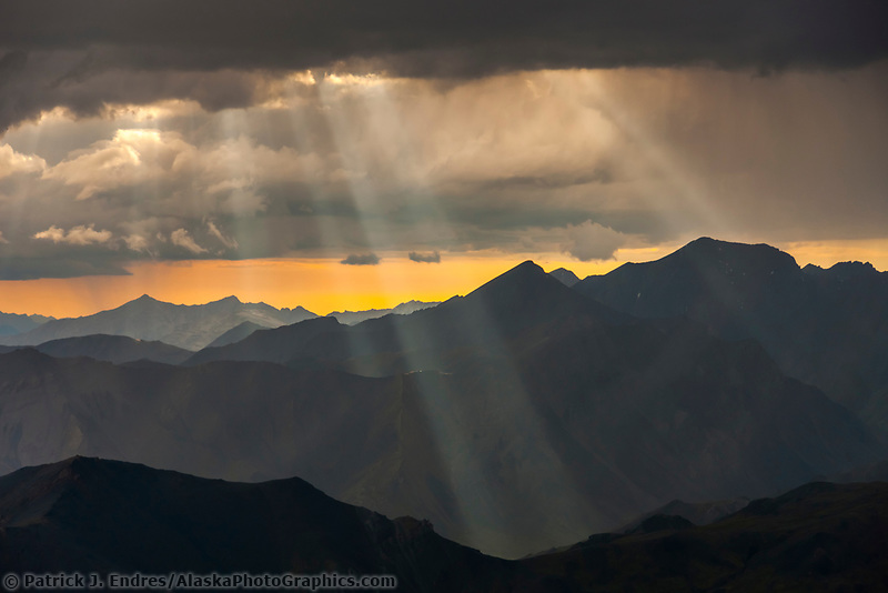 Aerial of light filtering through dramatic clouds in the Philip Smith mountains, Arctic National Wildlife Refuge, Brooks range Alaska.