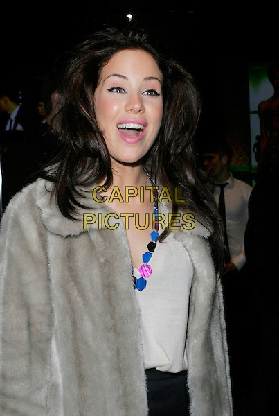 ROXANNE McKEE.Dolce & Gabbana Store, Old Bond Street, London, England. .December 13th, 2007. half length black grey gray beige fur coat jacket blue pink necklace.CAP/AH.©Adam Houghton/Capital Pictures.