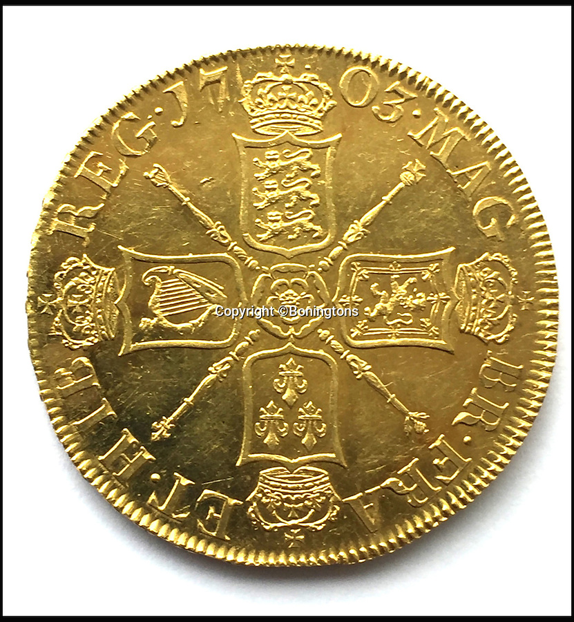 BNPS.co.uk (01202 558833)<br /> Pic: Boningtons/BNPS<br /> <br /> One of the only 20 'Vigo' Sovereigns made from melted down Spanish gold.<br /> <br /> Shiver me timbers...A toy pirates treasure chest throws up real gold coin worth £250,000.<br /> <br /> A labourer is set to reap a life-changing £250,000 windfall after discovering the rarest British coin ever made - in his four-year-old son's toy treasure chest.<br /> <br /> The 35-year-old had been given the 'lost' 300 year old Queen Anne Vigo five guinea coin by his late grandfather 30 years ago to play pirate games with.<br /> <br /> After he bought his own son a treasure chest he dug the coin out and gave it to him to play with before having an auctioneer have a look at it.<br /> <br /> It is to be sold by Essex auctioneers Bonningtons.