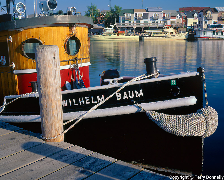 """Van Buren County, MI   <br /> Restored 1924 tugboat """"Wilhelm Baum"""" at the Michigan Maritime Museum, distant charter boats and shops of South Haven"""
