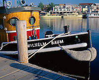 Van Buren County, MI   <br /> Restored 1924 tugboat &quot;Wilhelm Baum&quot; at the Michigan Maritime Museum, distant charter boats and shops of South Haven