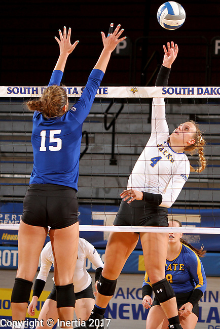 BROOKINGS, SD - SEPTEMBER 1: Ashlynn Smith #4 from South Dakota State University tips the ball over the net against Mattison DeGarmo #15 from CSU Bakersfield during their match Friday night at the Jackrabbit Invitational at Frost Arena in Brookings. (Photo by Dave Eggen/Inertia) (Photo by Dave Eggen/Inertia)