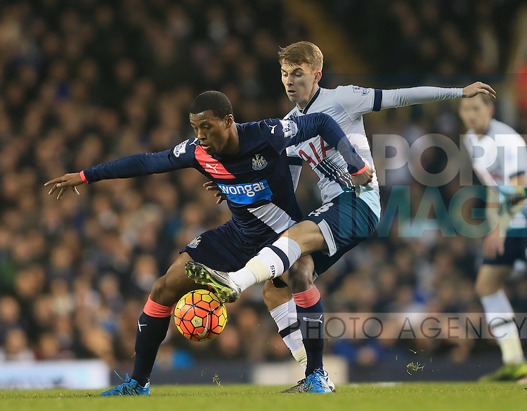 Tottenham's Tom Carroll tussles with Newcastle's Georgino Wijnaldum<br /> <br /> Barclays Premier League- Tottenham Hotspur vs Newcastle United - White Hart Lane - England - 13th December 2015 - Picture David Klein/Sportimage