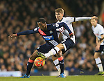 Tottenham's Tom Carroll tussles with Newcastle's Georgino Wijnaldum<br /> <br /> Barclays Premier League- Tottenham Hotspur vs Newcastle United - White Hart Lane - England - 13th December 2015 - Picture David Klein/Sportimage