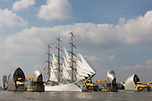 London, UK. 9 September 2014. The Polish Tall Ship Dar Mlodziezy passes the Thames Barrier. The Tall Ships that have taken part in the Royal Greenwich Tall Ships Festival 2014 leave Greenwich in a Parade of Sail down the River Thames.