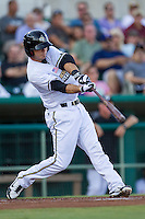 San Antonio Missions first baseman Tommy Medica (7) swings the bat during the Texas League baseball game against the Midland RockHounds on July 13, 2013 at Nelson Wolff Municipal Stadium in San Antonio, Texas. The Missions defeated the Rock Hounds 5-4. (Andrew Woolley/Four Seam Images)