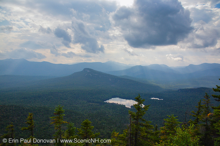 Storm clouds over Sawyer Pond from the summit of Mount Tremont in the White Mountains, New Hampshire USA.