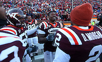 Nov 27, 2010; Charlottesville, VA, USA;  Virginia Tech Hokies defensive tackle John Graves (91) holds the Commonwealth Cup with fellow teammates Virginia Tech Hokies linebacker Davon Morgan (2), Virginia Tech Hokies defensive tackle Antoine Hopkins (56) and Virginia Tech Hokies defensive end Steven Friday (82) during the game at Lane Stadium. Virginia Tech won 37-7. Mandatory Credit: Andrew Shurtleff