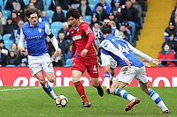 Ki Sung-Yueng of Swansea City (C) runs past Adam Reach (L) and Frederico Venancio of Sheffield Wednesday (R) during The Emirates FA Cup Fifth Round match between Sheffield Wednesday and Swansea City at Hillsborough, Sheffield, England, UK. Saturday 17 February 2018