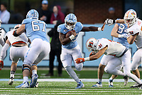 CHAPEL HILL, NC - NOVEMBER 23: Javonte Williams #25 of the University of North Carolina runs the ball during a game between Mercer University and University of North Carolina at Kenan Memorial Stadium on November 23, 2019 in Chapel Hill, North Carolina.