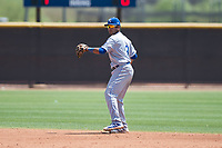 AZL Royals second baseman Rubendy Jaquez (3) throws to first base during an Arizona League game against the AZL Padres 1 at Peoria Sports Complex on July 4, 2018 in Peoria, Arizona. The AZL Royals defeated the AZL Padres 1 5-4. (Zachary Lucy/Four Seam Images)