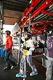 USA, Colorado, Aspen, skiers unload the gondola at the top of Ajax mountian, Aspen Ski Resort