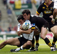 Twickenham, GREAT BRITAIN, 2004 Heineken Cup Final. Frazer Waters tackles XXXXXX , during the  London London Wasps v Toulouse, final at Twickenham on  23/05/2004  [Credit Peter Spurrier/Intersport Images]   [Mandatory Credit, Peter Spurier/ Intersport Images].