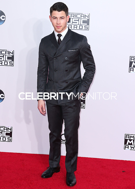 LOS ANGELES, CA, USA - NOVEMBER 23: Nick Jonas arrives at the 2014 American Music Awards held at Nokia Theatre L.A. Live on November 23, 2014 in Los Angeles, California, United States. (Photo by Xavier Collin/Celebrity Monitor)