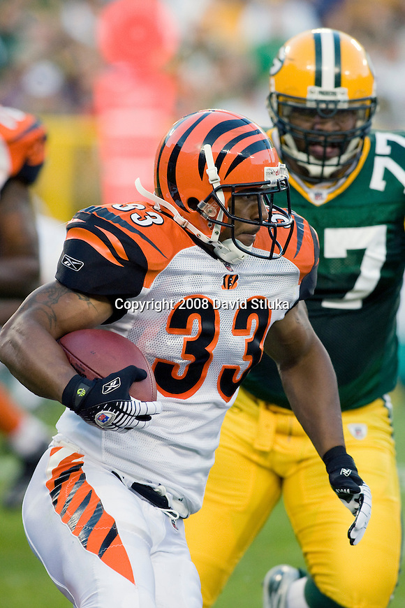 Running back Kenny Watson #33 of the Cincinnati Bengals carries the ball against the Green Bay Packers at Lambeau Field on August 11, 2008 in Green Bay, Wisconsin. The Bengals beat the Packers 20-17. (AP Photo/David Stluka)