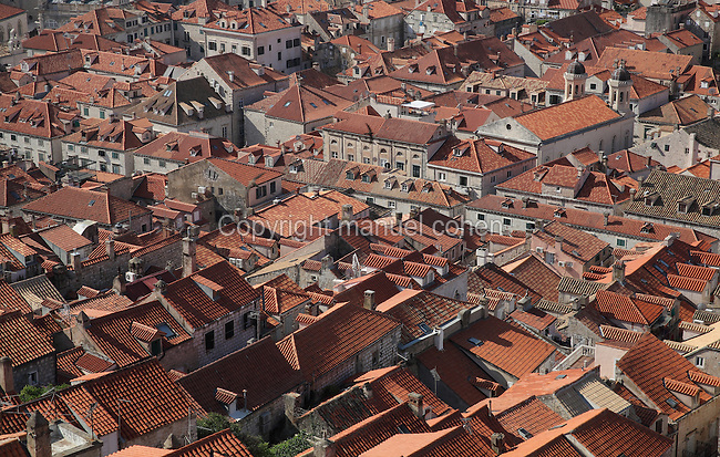 View over the rooftops of the medieval walled city, Dubrovnik, Croatia. The city developed as an important port in the 15th and 16th centuries and has had a multicultural history, allied to the Romans, Ostrogoths, Byzantines, Ancona, Hungary and the Ottomans. In 1979 the city was listed as a UNESCO World Heritage Site. Picture by Manuel Cohen