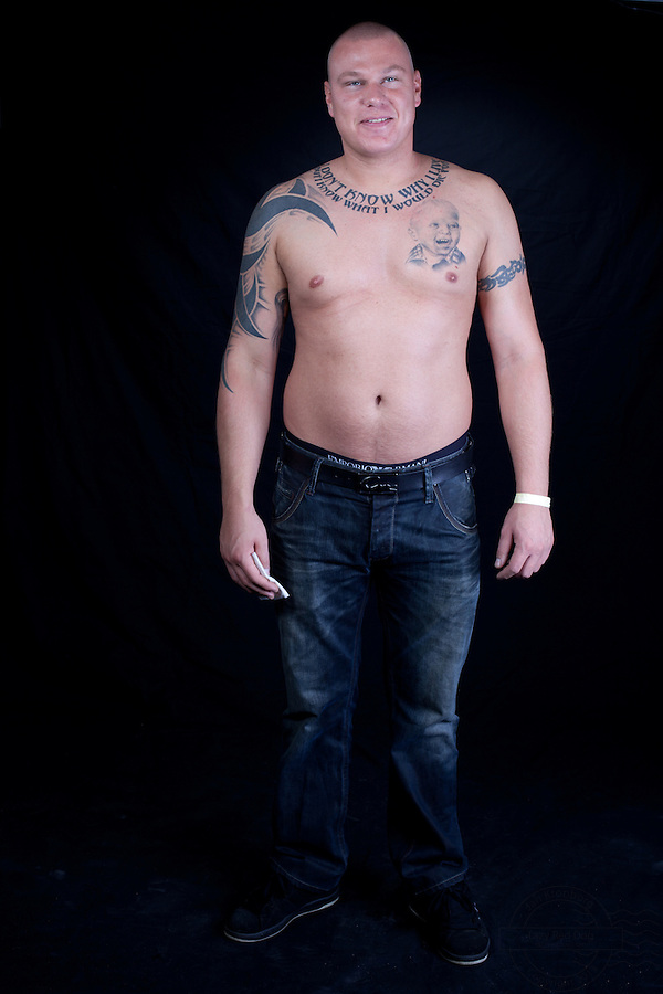 Danish man with a portrait of his son tattoed on the left side of his chest. On upper right arm a portrait of a woman.<br />