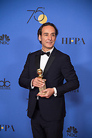After winning the category of BEST ORIGINAL SCORE &ndash; MOTION PICTURE for &quot;The Shape of Water,&quot; Alexandre Desplat poses with the award backstage in the press room at the 75th Annual Golden Globe Awards at the Beverly Hilton in Beverly Hills, CA on Sunday, January 7, 2018.<br /> *Editorial Use Only*<br /> CAP/PLF/HFPA<br /> &copy;HFPA/PLF/Capital Pictures